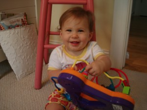 One of Cailee's favorite toys these days, not really to play with but to carry around.  Its almost as big as her though.